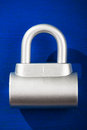 Padlock on blue chrome metal background Stock Photo