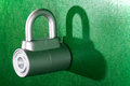 Padlock chrome metal on green background Stock Photo