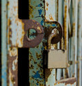 Padlock close up and grunge door Royalty Free Stock Image