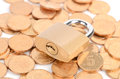 Padlock and coins Stock Images