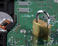 Padlock and computer hard disk drive Royalty Free Stock Photography
