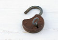 Padlock with key on white wood Stock Photo