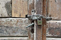 Padlock old wooden door with in the middle Stock Photo