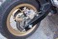 Padlock security lock blocking the motorcycle wheel on street, a Royalty Free Stock Photo