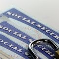 Padlock and social security card - Identity theft and identity protection concept Royalty Free Stock Photo