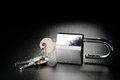 Padlock steel on the black textured background Royalty Free Stock Photography
