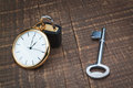 Padlock store time and the key controls. Royalty Free Stock Photography