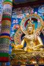 Padmasambhava a large gilded deity of the buddhist personality Stock Photo