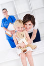 Paediatrician, mom, girl Stock Photography