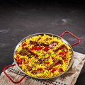 Paella al homo with black pudding and spare ribs Royalty Free Stock Photo