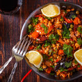 Paella with chicken, chorizo, seafood, vegetables and saffron. Royalty Free Stock Photo