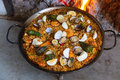 Paella cooked full on a wood fire at home Royalty Free Stock Photography
