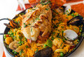 Paella with lobster shrimp mussels and clams Stock Images