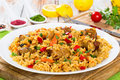 Paella with meat, pepper, vegetables and spices on dish Royalty Free Stock Photo