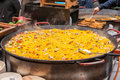 Paella rice dish in large cooking pan at market Royalty Free Stock Images