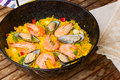 Paella traditional spanish dish in black pan rice Stock Images
