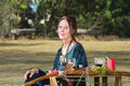 Pagan woman sitting outdoors adult with altar Royalty Free Stock Photography
