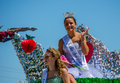Pagent roaylty on a float teen girl waves from her throne during the peach festival in coloma michgian however she is apple Royalty Free Stock Images
