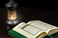 Pages of holy book Qur`an with vintage lamp Royalty Free Stock Photo