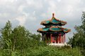 Pagoda the photo against the sky surrounded with trees Royalty Free Stock Image