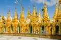 Pagodas encircle the gilded stupa of shwedagon pagoda base yangon myanmar Royalty Free Stock Image