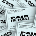 Paid in full words check money bills pile paying owed obligation on checks a to illustrate and being recouped with interest Royalty Free Stock Photography