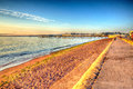 Paignton beach devon england colourful hdr on warm summer morning with blue sky in and colours Royalty Free Stock Images