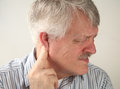 Pain around the ear Royalty Free Stock Photography