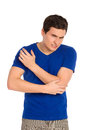 Pain in an elbow close up of young man massaging three quarter length studio shot isolated on white Stock Images