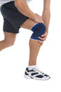 Pain in a knee sports trauma young sportsman has clasped hands sick to reduce Stock Photography