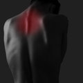 Pain in woman neck on dark background injury Stock Photography