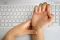 Pain on the wrist worker with by hard work at office Stock Image