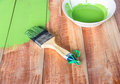 Paint brush and color bowl on wood board with green coating Stock Photography