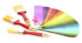 Paint brushes and bright palette of colors Stock Photography