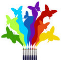 Paint brushes and colored butterflies rainbow Royalty Free Stock Photo