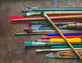 Paint brushes and office supplies set of on the table Royalty Free Stock Images