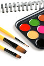 Paint brushes and sketch book paints Royalty Free Stock Photos
