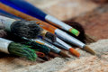 Paint brushes up close used artist on a rough wooden surface Royalty Free Stock Image