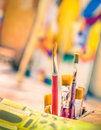 Paint brushes in a vintage colorful atelier detail of Stock Image