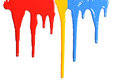 Paint dripping in primary colors isolated on a white background Stock Images
