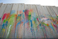 Paint on israeli separation wall a rainbow of splattered colors covers the in the palestinian town of abu dis Stock Photography