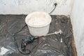 Paint mixer and bucket Royalty Free Stock Photo