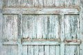 Paint-peeling wooden old door texture Royalty Free Stock Photo