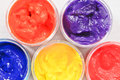 Paint pots close up of colorful paints in plastic Royalty Free Stock Photo