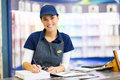 Paint store clerk beautiful female working Stock Photography
