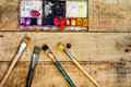 Paint tools on wood planks background Royalty Free Stock Photo