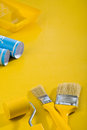 Paint tools on yellow table Royalty Free Stock Images