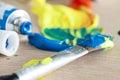 Paint tube and brush acrylic Royalty Free Stock Photo