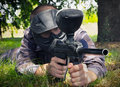 Paintball player hidding in the forest Royalty Free Stock Image