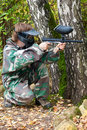 Paintball player is hiding and shooting aside Stock Photo
